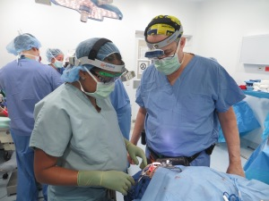 Dr. Robert Gilman, MD, DMD, and Clinical Lecturer in Plastic Surgery at the University of Michigan, performing plastic surgery on a mission trip to Cartagena, Colombia, using Enova LED surgical headlights