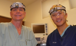 Dr. Daniel Klemmedson (left) wearing his Cyclops XLT-125 with Dr. Lew, his partner who now uses Dr. Klemmedson's Iris S-100.